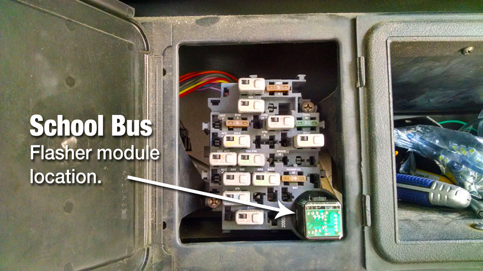 The 1995 International school bus has a much better flasher module location.