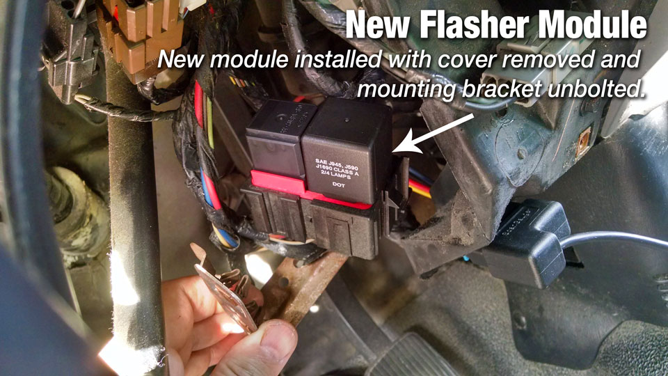 Remove the two bolts holding the bracket, it makes access to flasher module much easier.