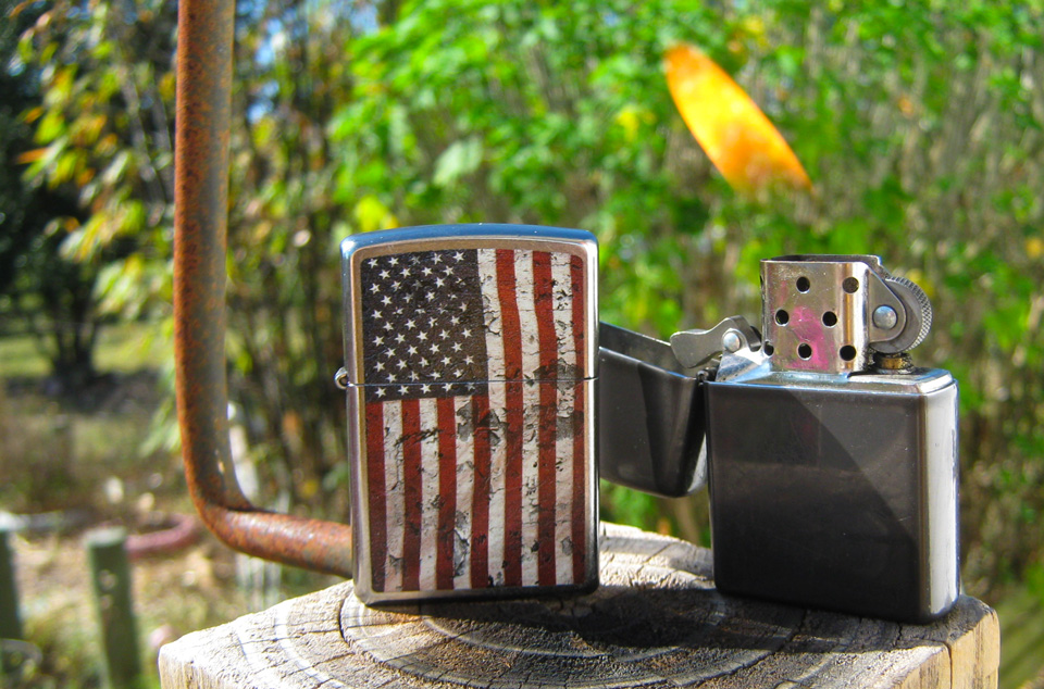 Two Zippo Lighters in my back yard
